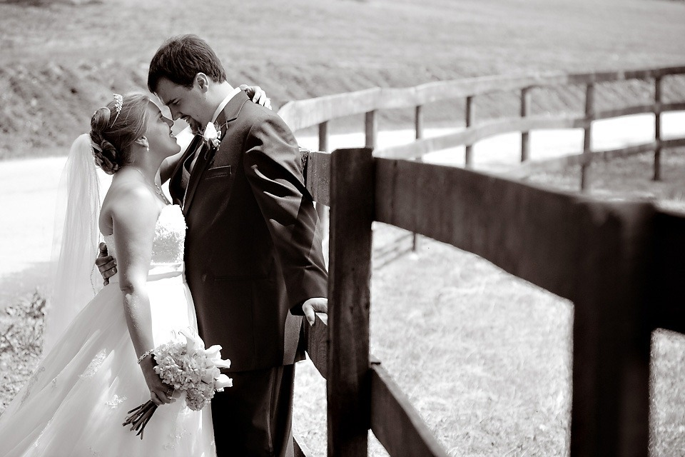 Bride and Groom at fence