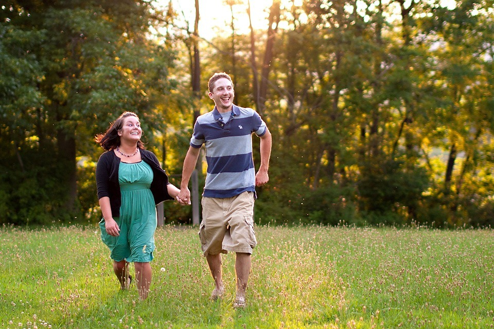 Couple running through field at Memorial Lake Park, Grantville PA