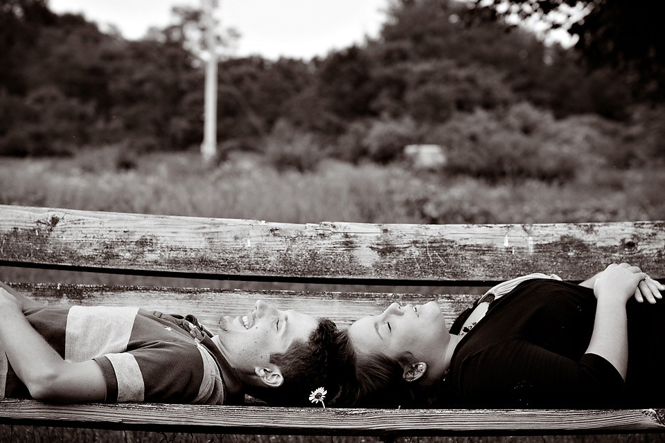 couple laying on bench