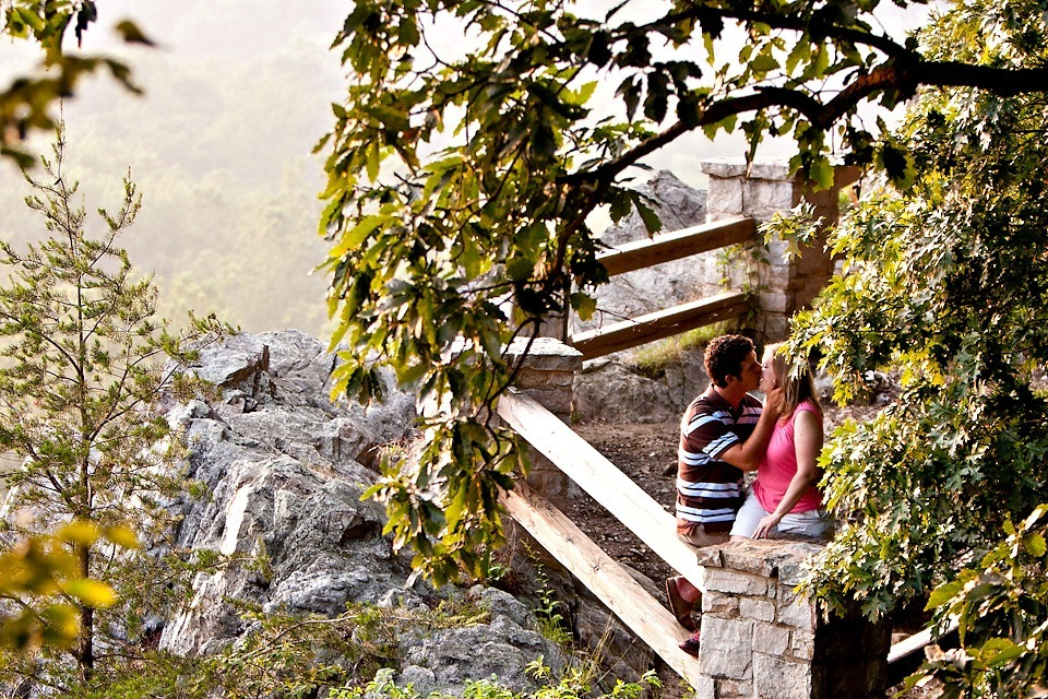 Couple kissing at overlook in Chickies Rock Park