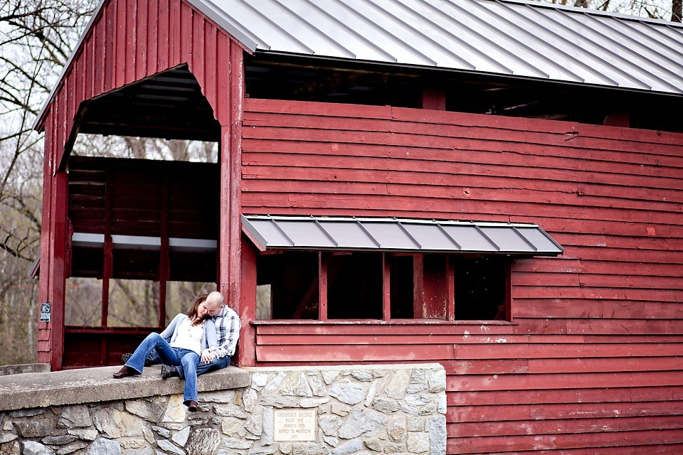 a couple on a covered bridge