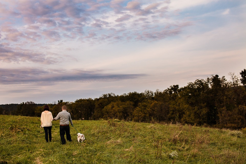 Couple walking in field at Blue Hound Farm, Lewisberry PA