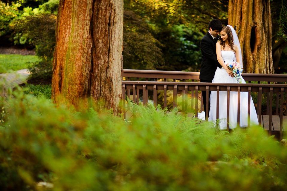 bride and groom on bridge at Hershey Gardens