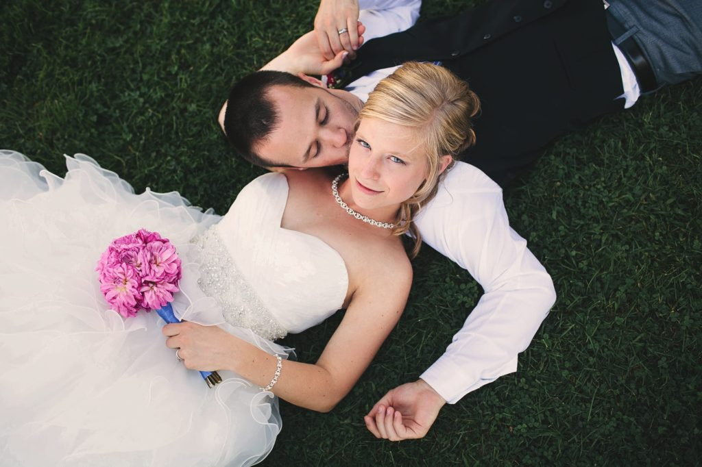 Bride and Groom laying in the grass in Williamsport, PA